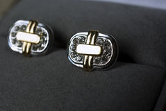 Cuff links in a box. Gold cuff links with precious stones, in a box stock photos