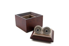 Cuff links in a box. On white background royalty free stock photo