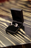 Cuff Links in Box. Cuff links in black box on table stock image
