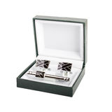 Cuff links in a box on white background stock photos