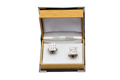 Cuff links in a case on the white Stock Photos