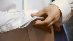 Cuff Links. Man putting on his cuff links stock footage