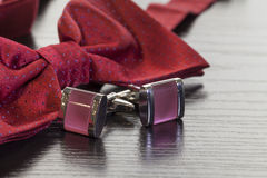 Cuff links and red bow tie Royalty Free Stock Photo