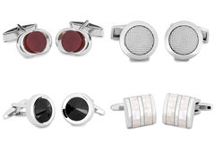 Cuff links. Stainless steel cufflinks isolated on white background stock photography