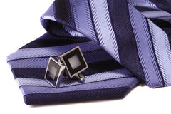 Cuff links and tie. White background Royalty Free Stock Images