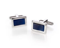 Cuff links on white. Background stock photos