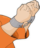 Cuffed Hands and Orange Shirt Stock Image