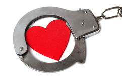 Cuffed heart. Isolated on white background Royalty Free Stock Photo