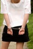 Cuffed teenage girl. Beautiful teenage girl in handcuffs Stock Photography