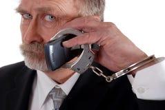Cuffed zum Telefon Stockbild