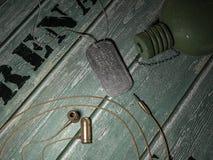 Cuffia avricolare della pallottola, boccetta e concetto del segno Fotografia Stock