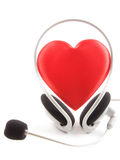 Cuffie del cuore e un microfono Fotografia Stock