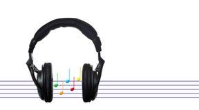 Cuffie nere con il segno musicale immagine stock