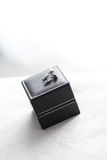 Cufflink on the black box Stock Photo