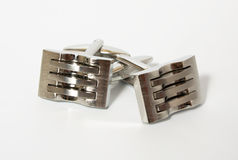 Cufflinks. A pair of stainless steel cufflinks on white stock photo