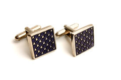 Cufflinks. A pair of stainless steel cufflinks on white Stock Image