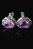 Cufflinks with amethyst isolated Royalty Free Stock Photos
