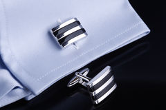 Cufflinks on blue shirt Royalty Free Stock Photo