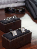 Cufflinks display. Display of men's diamond and silver cufflinks royalty free stock photo
