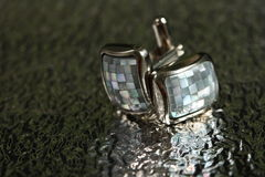 Cufflinks small Royalty Free Stock Image