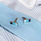 Cufflinks and striped blue shirt with tie Royalty Free Stock Photography