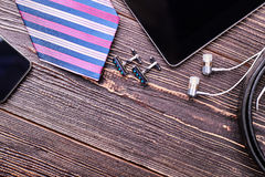 Cufflinks and striped necktie. Royalty Free Stock Images