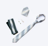 Cufflinks, tie and tie clip, handkerchief and box isolated on wh Stock Photography