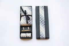 Cufflinks, tie, tie clip, handkerchief in box. Stock Photo