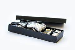 Cufflinks, tie and tie clip, handkerchief in gift box. Stock Photo