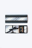 Cufflinks, tie and tie clip, handkerchief in gift box. Stock Photography
