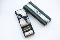 Cufflinks, tie, tie clip, handkerchief and gift box. Stock Image
