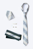 Cufflinks, tie and tie clip, handkerchief and gift box. Stock Images
