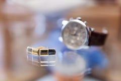 Cufflinks and wristwatch Stock Photo