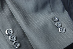 Cuffs of a bespoke tailored suit. Cuffs of a tailored pinstripe business suit Stock Image