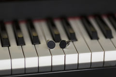 Cuffs over a piano. Cuffs over the piano keys Stock Image