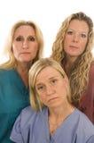 cuida la expresión seria de las hembras médicas Imagen de archivo libre de regalías