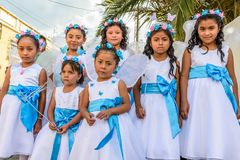 Girls dressed up as angels in parade, Guatemala. Cuidad Vieja,, Guatemala -  December 7, 2017: Girls dressed up as angels in parade celebrating Our Lady of the Royalty Free Stock Photography