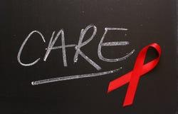 Cuidado da fita da consciência do SIDA fotos de stock