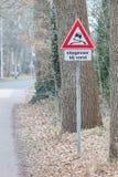 Cuidado de la señal de tráfico resbaladizo cuando frío, holandés Fotos de archivo libres de regalías
