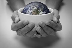 Cuidado de la tierra y de la gente del ahorro Imagen de archivo