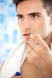 Cuidado de los labios del hombre Foto de archivo libre de regalías