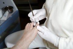 Cuidado de pie - Pedicure - quiropodia Fotos de archivo libres de regalías