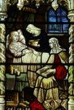 Cuidado de una persona enferma en vitral Imagen de archivo libre de regalías