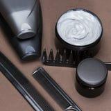 Cuidado del cabello y productos y accesorios el diseñar fotos de archivo