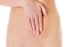 Cuidado do corpo, conceito da dieta da gravidez, mulher que guarda as mãos no estômago imagem de stock