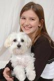 Cuidado do filhote de cachorro foto de stock royalty free