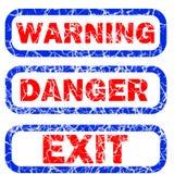 Cuidado, peligro, y sello de la salida Fotografía de archivo