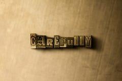 CUIDADOSAMENTE - el primer del vintage sucio compuso tipo de palabra en el contexto del metal Imagen de archivo libre de regalías