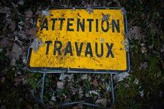 Cuidadoso, trabalhos em curso no francês imagem de stock royalty free