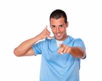 Cuide al individuo con gesto de la llamada que señala en usted Imagen de archivo